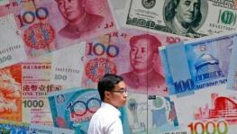 China's Allows Yuan to Fall Below Sensitive Level of 7 to US Dollar