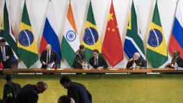 China's President Xi Jinping, left, Russia's President Vladimir Putin, second from left, Brazil's President Jair Bolsonaro, center, India's Prime Minister Narendra Modi, second from right, and South Africa's President Cyril Ramaphosa leave after a meeting during the BRICS emerging economies, Brasilia, Brazil