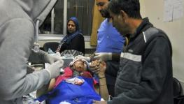 Paramedics at a hospital in Damascus treat the wounded after the Israeli missile strikes on Tuesday, November 20.