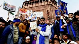 Bhim Army chief Chandrasekhar Azad holds a copy of the 'Indian Constitution' during a protest against Citizenship (Amendment) Act at Jama Masjid in New Delhi on Friday