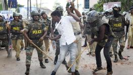 Police clash with a protester during demonstrations against the Citizenship Act in Mangaluru on December 19, 2019. |
