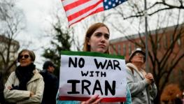 A protester holds an anti-war sign in the US. (Photo: Getty Images)