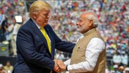 "PM Modi shakes hands with US President Donald Trump at ""Namaste Trump""event held in Ahmedabad."