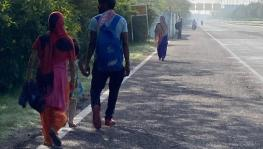 A family walking back to the village in Uttar Pradesh during the lockdown.