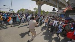 Migrant workers and police clash in Ahmedabad