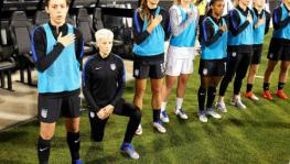 Megan Rapinoe of the US women's national team takes a knee in protest during the national anthem