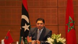Morocco's foreign minister chairing the meeting of delegates of rival governments in Libya on Sunday, September 6