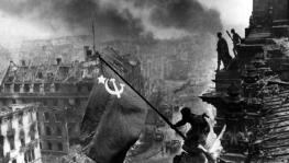 Yevgeny Khaldei's iconic photo of the Red Army soldiers raising the Soviet flag on top of the Reichstag building in Berlin, May 1945.