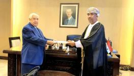 Walid al-Muallem, Syria's deputy prime minister and foreign minister (L) receives the credentials of Oman's Ambassador Turki bin Mahmood al-Busaidy, Damascus, October 5, 2020