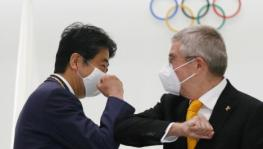 Former Japanese PM Shinzo Abe with IOC chief Thomas Bach