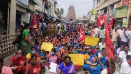 Community health workers in India blockade a road during the historic strike on November 26. Source Newsclick