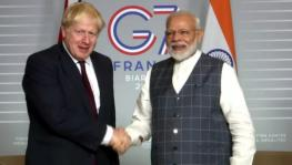 Prime Minister Modi (R) and UK PM Boris Johnson. File photo