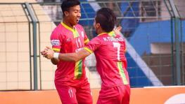 Bidyashagar Singh and Komron Tursunov of Trau FC in the I-league