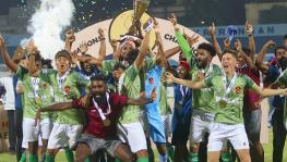 Gokulam Kerala FC players with the I-league trophy