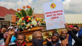 26 February 2021: Thami Molefe's colleagues carry his coffin through the streets. Molefe was one of three ArcelorMittal employees who died recently at the company's Vanderbijlpark plant. (Photographs by Magnificent Mndebele)