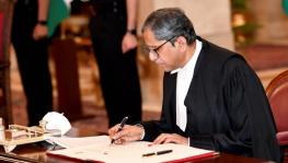 CJI NV Ramana signs the register after being sworn in as CJI in Rashtrapati Bhavan.