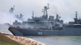 Russian military's armoured vehicles roll into landing vessels after drill in Crimea, Black Sea, April 23, 2021