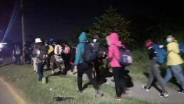 A small group of Honduran migrants left from the city of San Pedro Sula in a new migrant caravan for the United States on March 30. Photo: Gilda Silvestrucci/Telesur