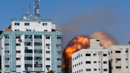 Israel Air Strike in Gaza Flattens Building with AP, Al Jazeera, Other Media