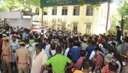 People awaiting Remdesivir medication gather as an announcement is made outside the Government Kilpauk Medical College Hospital in Chennai.