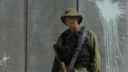 Israeli Soldier in front of wall.jpg