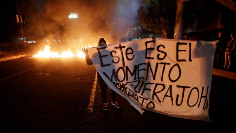 "Photo from one of the road blockades in Tegucigalpa, the banner reads: ""This is the moment, OUT JOH"""