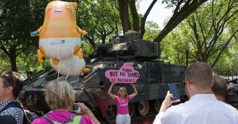"CodePink's Medea Benjamin poses in front a tank ahead of the ""Salute to America"" Fourth of July event with US President Donald Trump at the Lincoln Memorial on the National Mall in Washington, DC, on July 3, 2019."