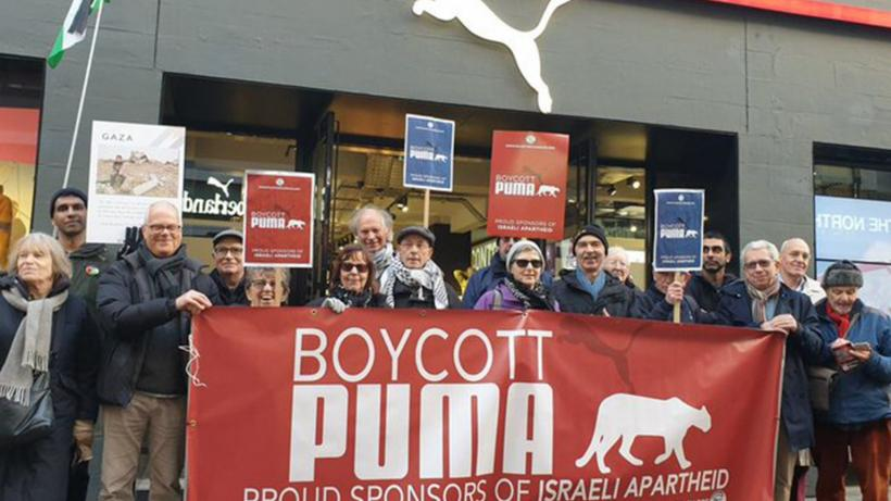 Protestors outside a Puma flagship store in London demanding the company end its sponsorship deal with the Israel Football Association (IFA). (@PACBI/ Twitter)