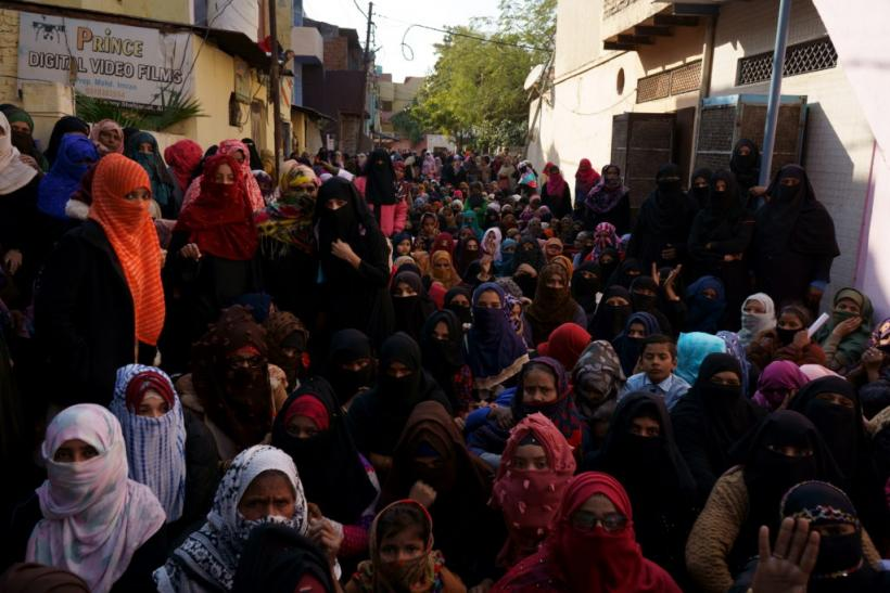 Women resisting police from entering the protest site in Shah Jamal, Aligarh