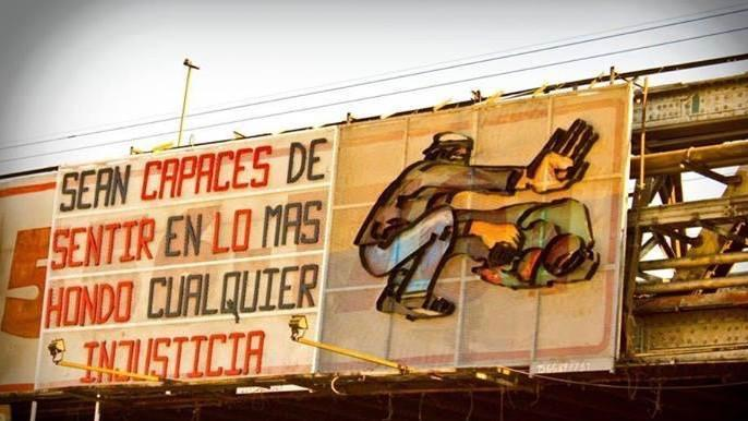 "Popular art installation at the Darío and Maxi station in Buenos Aires, ""Be capable of feeling any injustice deeply."""