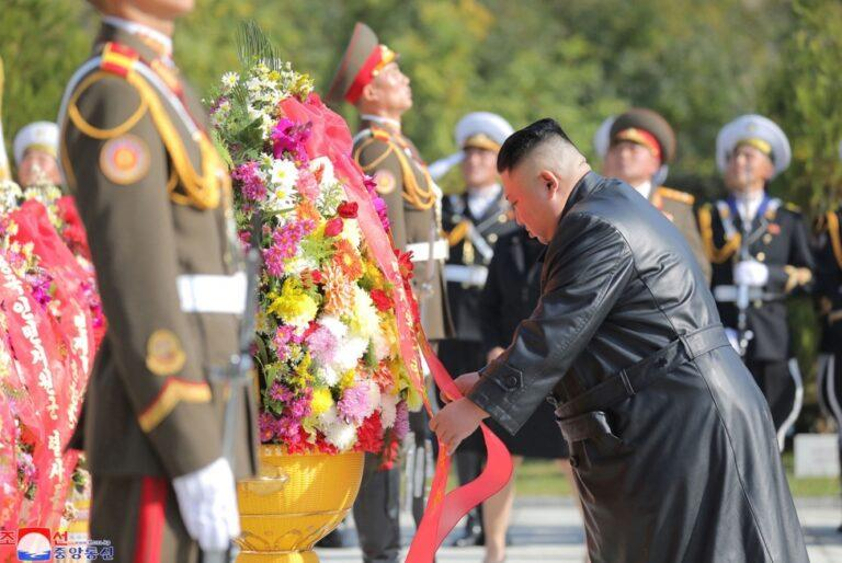 North Korean leader Kim Jong Un (R) placing wreath at monument to martyrs of Chinese People's Volunteer Army who fought in Korean War.