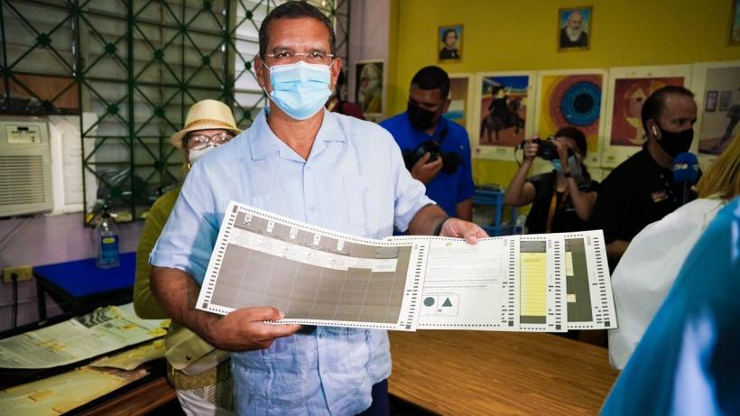 Pedro Pierluisi of the right-wing New Progressive Party (PNP) casts his vote. He is leading the gubernatorial race in Puerto Rico with a narrow margin of less than 1% of the votes with 91% of the votes counted. Photo: Pedro Pierluisi twitter