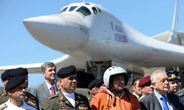 Venezuelan defence minister, Vladimir Padrino López, second left, greeting the arrival of two Russian Tupolev Tu-160 long-range nuclear-capable heavy supersonic bombers, Caracas, December 10, 2018
