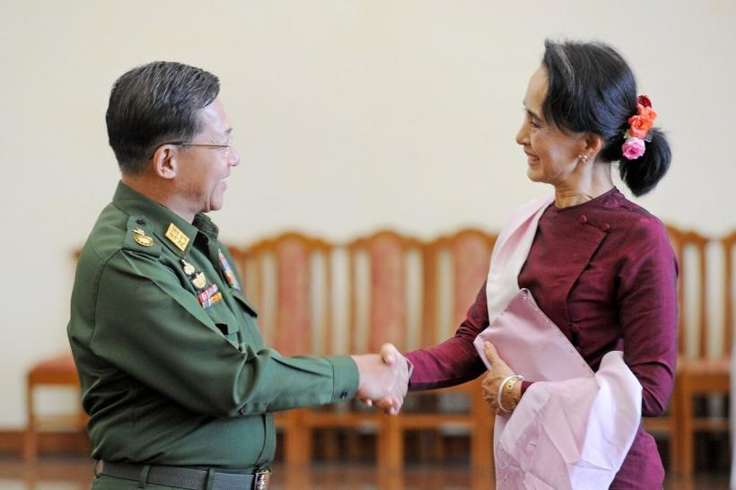 n this file photo dated Dec. 2, 2015 Myanmar military chief General Min Aung Hlaing (L) and National League for Democracy party leader Aung San Suu Kyi (R) shake hands after their meeting at the Commander-in-Chief's office in Naypyidaw.