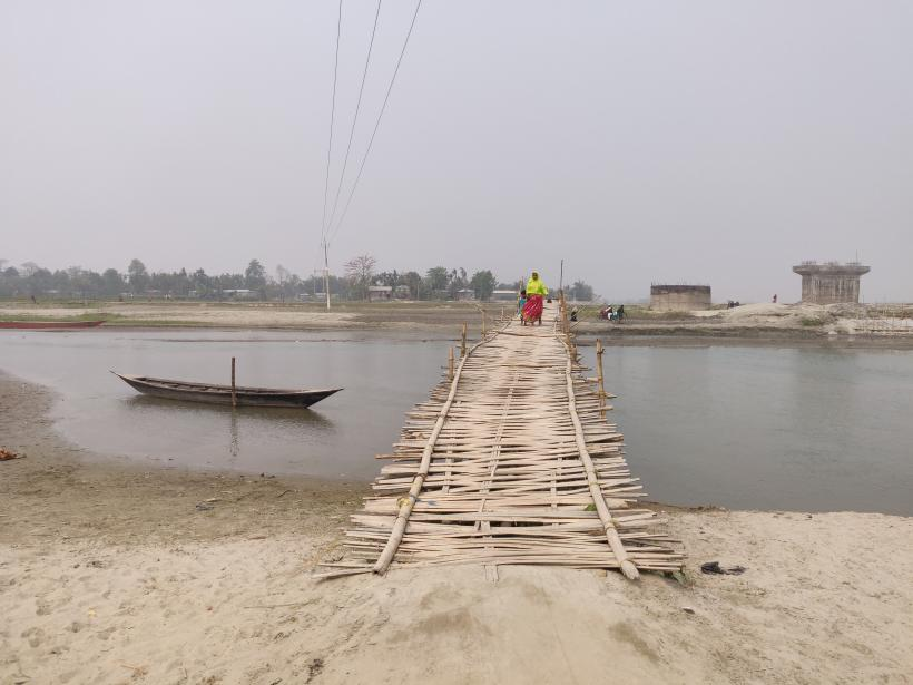 Kids have to cross these bamboo bridges to go to school